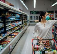 Woman with mask on shopping in the supermarket